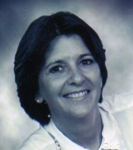 black and white photo of caucasian woman smiling with short dark hair
