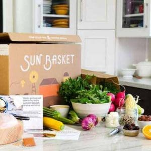 sun basket box on kitchen counter with fresh vegetables