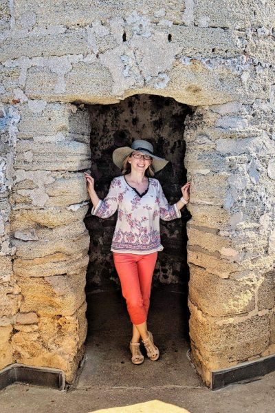 woman standing in a turret in the Castillo de San Marcos in St Augustine Florida