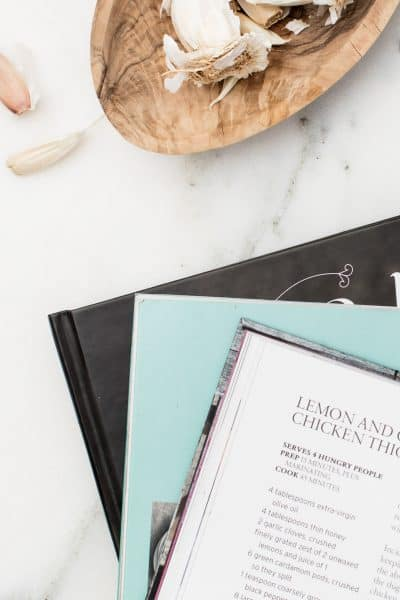 open cookbook on marble counter